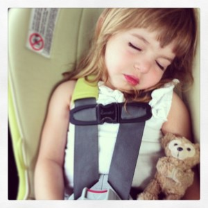 Asleep in her car seat with a bear